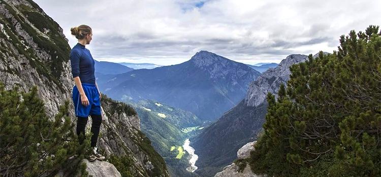 hiker enjoying the view over the Julian Alps