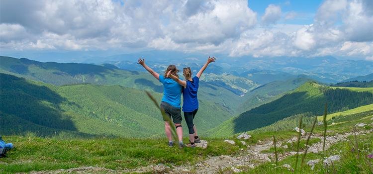 two women enjoying the view over Romanian mountains
