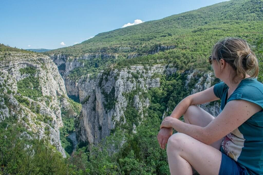 Emma looking out into the Verdon Gorge while walking in France