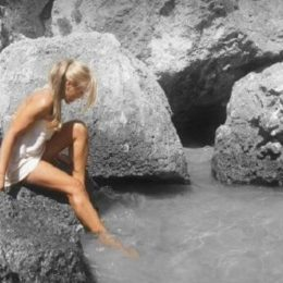 Woman bathing in the natural pool of Courmayeur